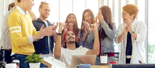 Obraz na plátně  Multiethnic diverse asian college group celebrate win success with team feeling happy