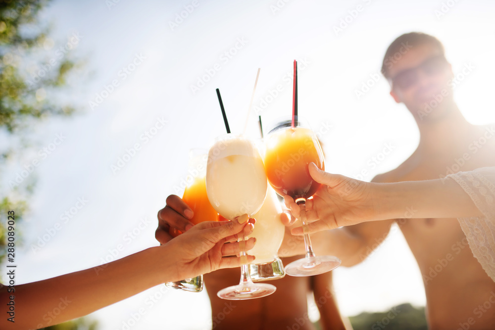 Fototapety, obrazy: Close up of millennials drinking summer cocktails