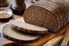 Sliced Rye Bread On A Rustic C...