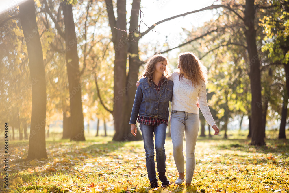 Fototapety, obrazy: Senior woman having a walk with daughter