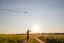 A Child Plays With A Kite At S...