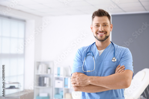 Male nurse with stethoscope in clinic