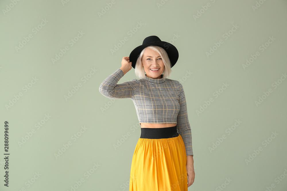 Fototapety, obrazy: Stylish mature woman on color background
