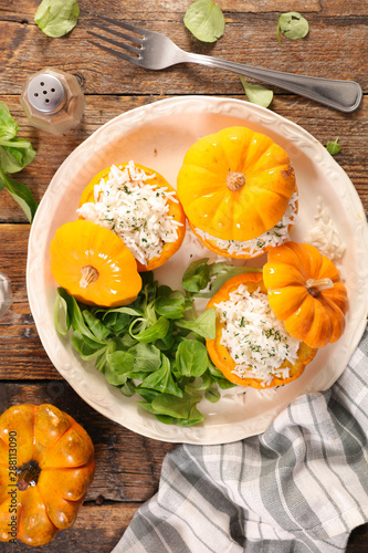 Türaufkleber Natur stuffed pumpkin with rice and salad, top view