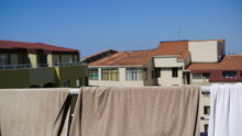 Beach Towels Are Dried On The Balcony On A Sunny Day
