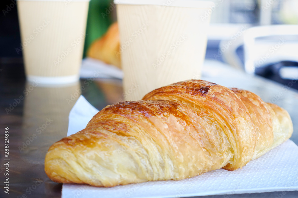 Fototapety, obrazy: Breakfast with coffee and croissants on table