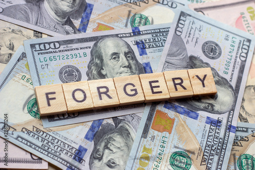 Valokuva The word forgery on dollar usa background