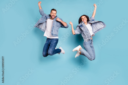 Vászonkép  Photo of overjoyed joyful cute nice couple of spouses jumping flying in air happ