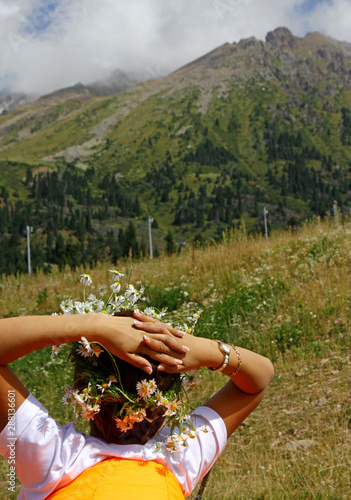 Spoed Foto op Canvas Olijfboom Relaxed woman with flowers in her hair in the mountains near Almaty, Kazakhstan