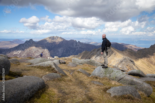 Photo man standing at the top of goat fell on arran