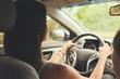 Woman driving a car. Rear view.