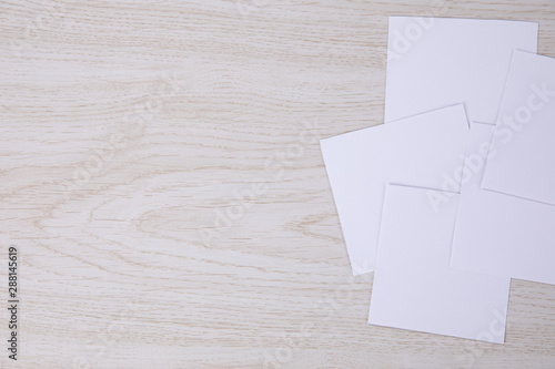 White empty post-it note posed on a wooden background