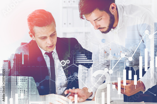 Two businessmen in office, graphs Fototapet