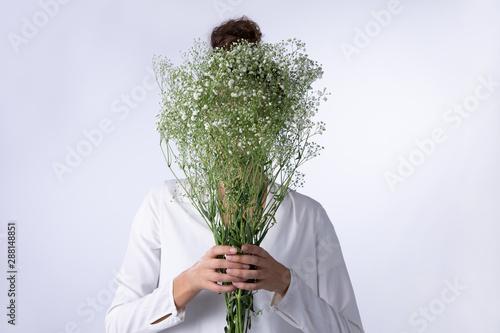 Women behind baby breath flowers bouquet