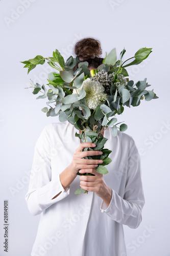 Women behind dahlia flowers bouquet