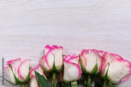 Flowers lying on a wooden table