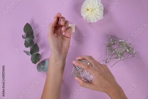 Woman testing a perfume on her wrist