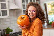 Portrait Of Beautiful Woman Holding A  Pumpkin
