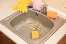 Close Up On Dirty Clogging Kitchen Sink Drain With Food Particles