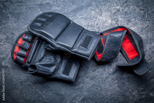 Mixed martial arts black gloves on gray background Wallpaper Mural