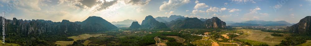 Beautiful City of Vang Vieng aerial Panorama Limestone Mountains at Sunset