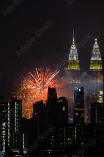The Kuala Lumpur skyline glittered with a kaleidoscope of colours and spectacular lights and sound to mark the nation's 62 years of independence of Malaysia Wallpaper Mural