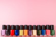 canvas print picture Set of various nail polish bottle on pink background with copy space. Stylish trendy nail polish for female manicure. Colorful nail lacquer top view