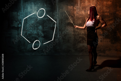 Fotografie, Obraz  Sexy girl or secretary or female student presenting handdrawn chemical formula o