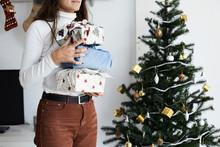 Holding Furoshiki Wrapping Mismatched Gift.