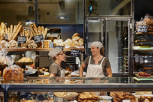 Two Saleswoman In A Bakery