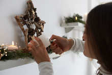 Faceless Woman Lighting Candle Christmas.