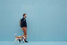 Man Walking The Dog Against Th...