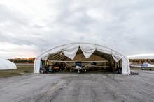 Biplane In Hangar On Aerodrome