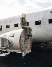 Aviator Sitting On Broken Plane Engine