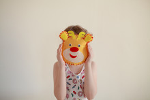 Child With Mask Of Animal