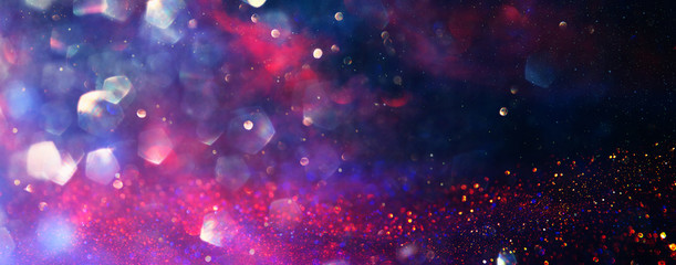 background of abstract red, gold and purple glitter lights. defocused. banner