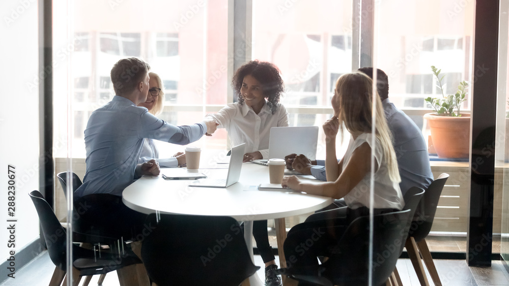 Fototapety, obrazy: Smiling diverse employees handshake greeting at office meeting