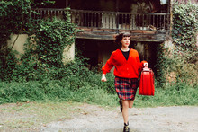 Woman With Red Suitcase Runnin...
