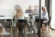 Multiethnic employee brainstorm discuss ideas together in boardroom