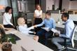 Smiling employees handshake getting acquainted at informal meeting