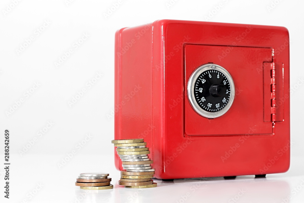Fototapety, obrazy: saving money in a red money box with stack of coins white background no people stock image and stock photo