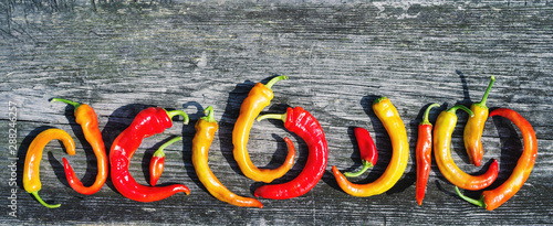 Keuken foto achterwand Hot chili peppers Red hot chili peppers on old wooden background