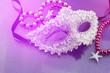 Leinwanddruck Bild - A festive,Beautiful white mardi gras or carnival mask on beautiful purple paper background