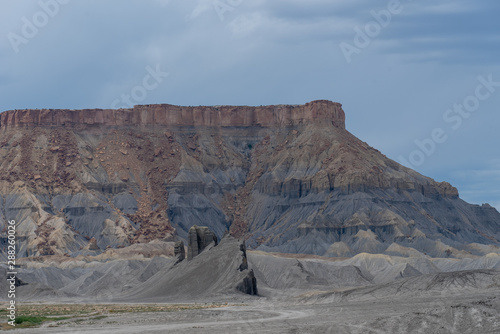 Landscape of barren blue and grey hillside near Hanksville, Utah
