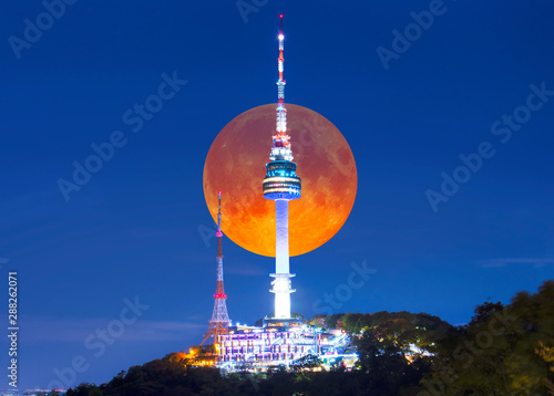 Super full Moon with Seoul tower at night in Seoul, South Korea. Wallpaper Mural