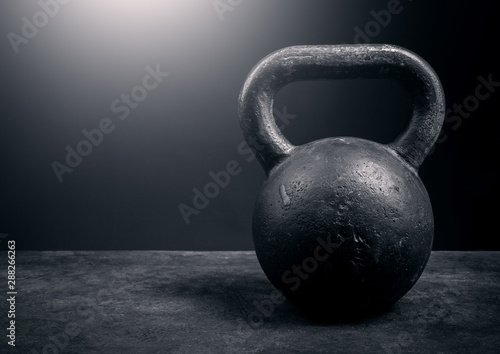 Black kettlebell on a black background Obraz na płótnie
