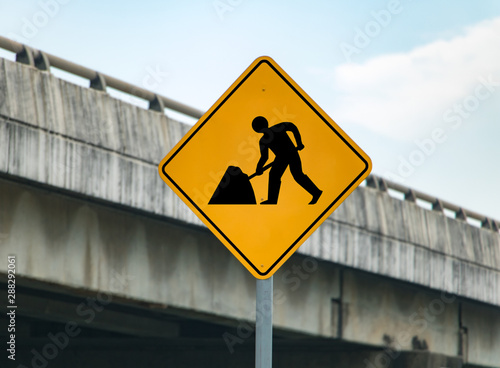 Road sign informs about road work. Warning of reconstruction of the path.