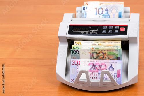Fototapeta  Belarusian Ruble in a counting machine