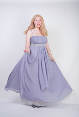 Young mix race happy adult woman in a grey long shiffon evening wear