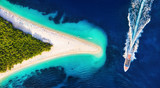 Croatia, Hvar island, Bol. Aerial view at the Zlatni Rat. Aerial view of luxury floating boat on blue Adriatic sea at sunny day. Travel - image